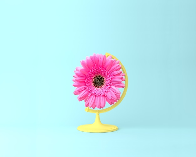 Globe sphère orbe concept de fleur rose sur fond bleu pastel. fleurs minimales ou printanières