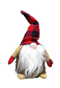 Un gnome scandinave de noël de jouet dans un chapeau rouge avec une barbe d'isolement