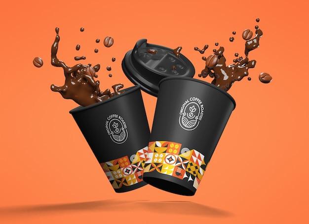 Gobelets en papier à motifs noirs et colorés flottants avec maquette de café éclaboussant sur fond orange
