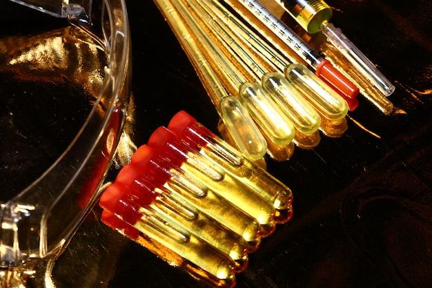 Gold science medical r & d, compte-gouttes, lunettes, seringue, stéthoscope, outils de test de laboratoire sur tube de verre