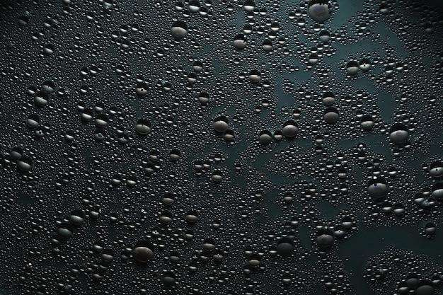 Gouttes d'eau sur une surface grise. effet de texture à bulles.