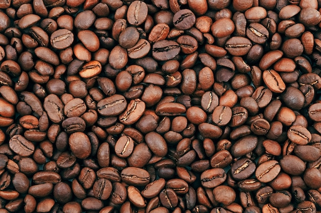 Grain de café fond brun foncé grains de café torréfiés