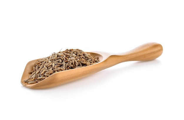 Graines de carvi en cuillère en bois