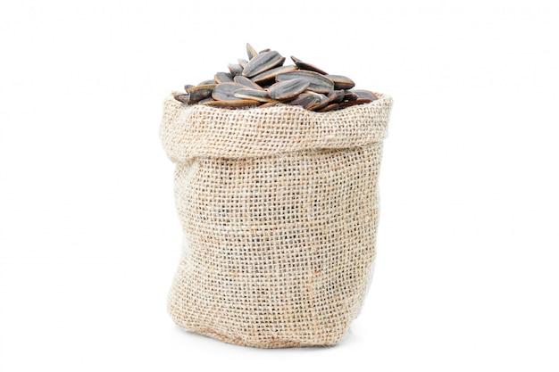 Graines de tournesol en sac sur blanc