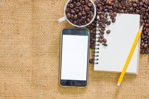 Grains de café avec carnet