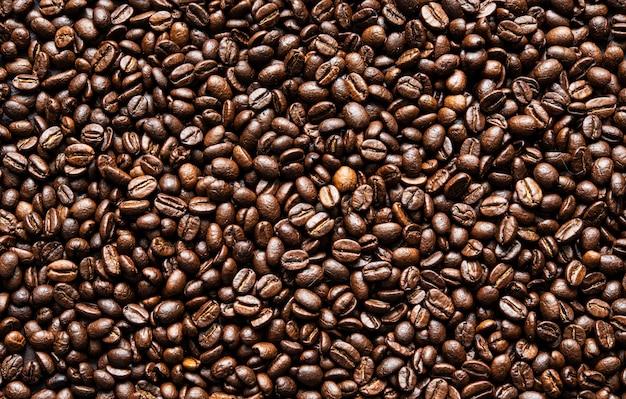 Grains de café frais fond de texture de graine brune fond d'écran complet