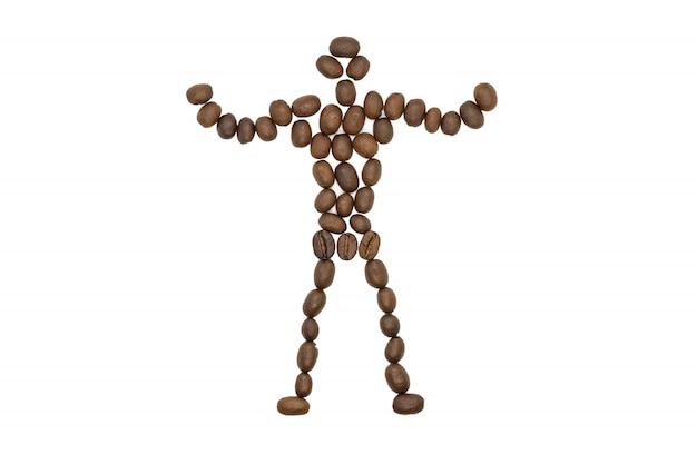 Grains de café torréfiés, forme de petit homme, isolé.
