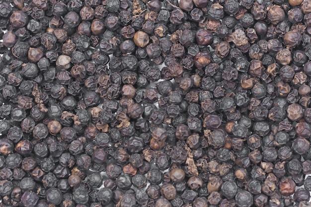 Grains de poivre noir comme toile de fond