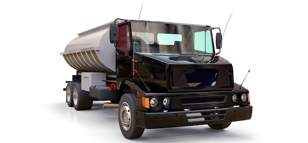 Grand camion-citerne noir avec une remorque en métal poli