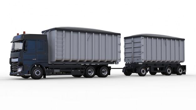 Grand camion noir avec remorque séparée, pour le transport de matériaux et de produits agricoles et de construction en vrac