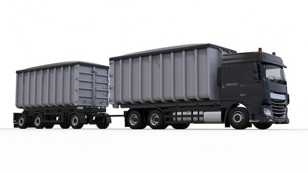Grand camion noir avec remorque séparée, pour le transport de matériaux et de produits agricoles et de matériaux de construction en vrac