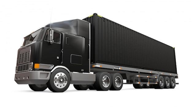 Un grand camion noir rétro avec une partie couchage et une extension aérodynamique porte une remorque avec un conteneur maritime