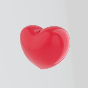 Grand coeur rouge isolé sur un mur blanc avec effet de réflexion