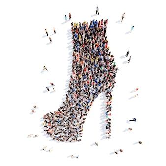 Grand groupe de personnes sous forme de chaussures. fond blanc isolé.