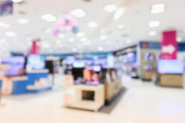Grand magasin eletronic show télévision tv et appareil ménager avec arrière-plan flou clair bokeh