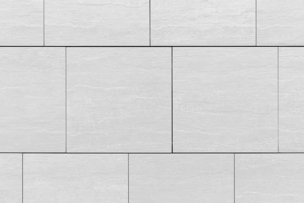 Grand motif de carreaux gris sur le mur, gros plan de fond
