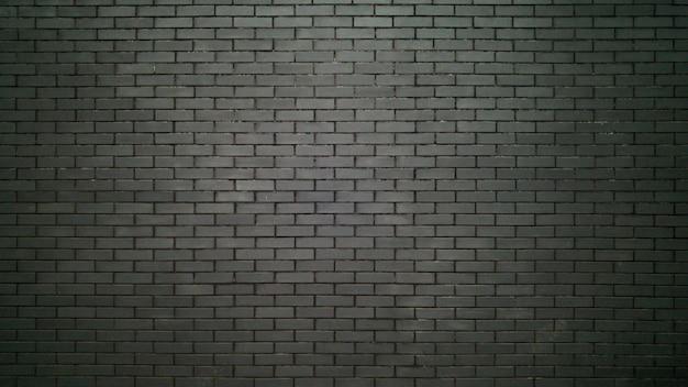 Grand mur noir en briques. texture de briques noires
