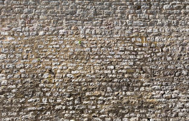 Grand vieux fond de mur de pierre
