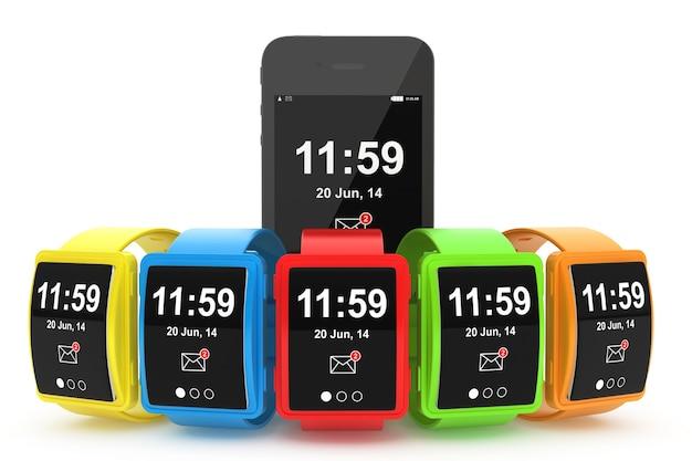 Grandes montres intelligentes multicolores conceptuelles avec téléphone portable sur fond blanc