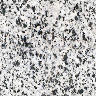 Le granit a une texture transparente fond clair en pierre naturelle