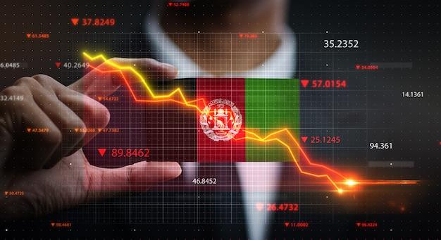 Graphique tombant devant le drapeau de l'afghanistan. concept de crise