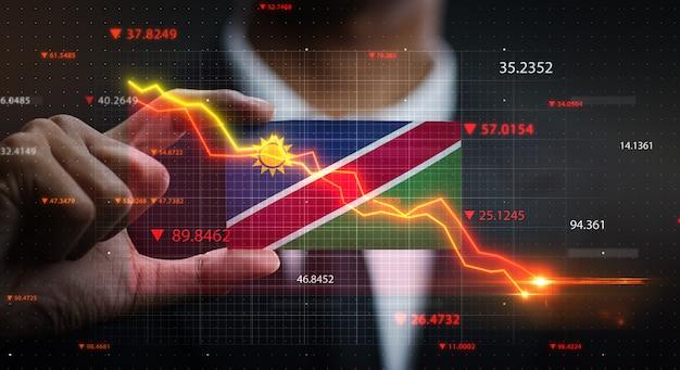 Graphique tombant devant le drapeau de la namibie. concept de crise