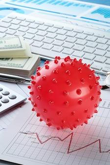 Graphiques et histogrammes, virus. concept du déclin de l'économie mondiale en raison de l'épidémie de coronavirus. chute des indicateurs financiers et des revenus, effondrement des cours des actions et des titres.