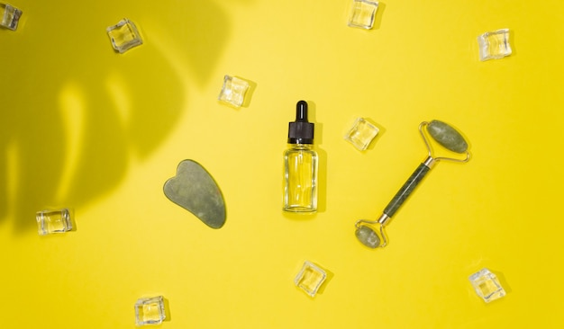 Grattoir jade gua sha, masseur de visage à rouleaux et huile cosmétique