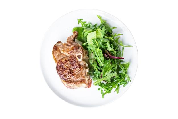 Grillade de viande bifteck chaud bifteck salade fraîche de boeuf sur l'agneau d'os ou collation de boeuf