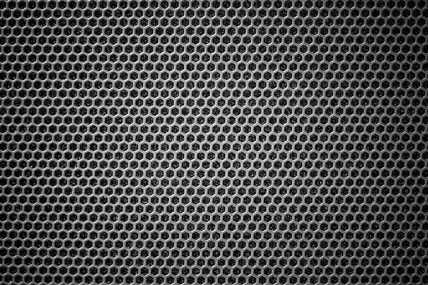 Grille en acier noire avec trous hexagonaux