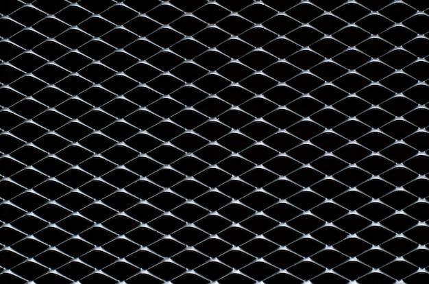 Grille gris foncé et argentée d'une clôture en métal