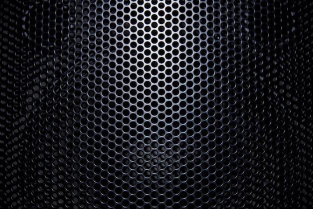 Grille de protection à fond noir avec lumière.