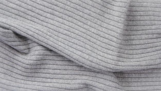 Gris tricoté. tissu tricoté, texture laine