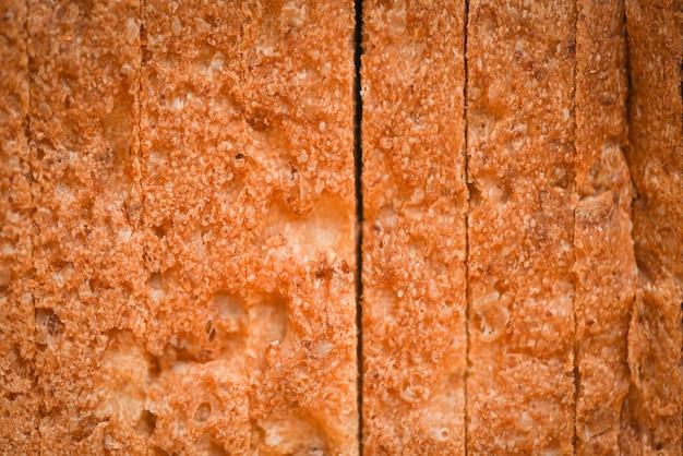 Gros fond de texture en tranches de pain - pain de blé entier coupé