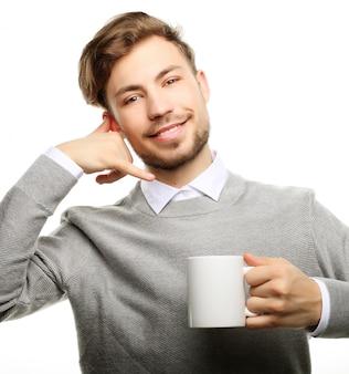 Gros homme d'affaires avec une tasse de café