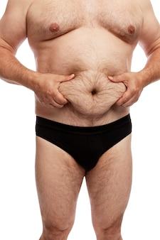 Gros homme avec un gros ventre. vue de côté. isolé.