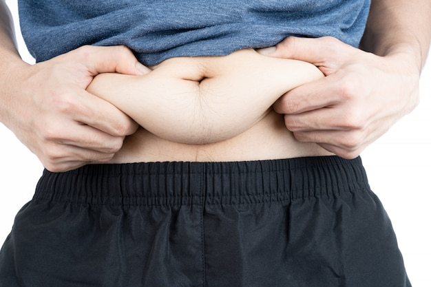 Gros homme tenant un ventre gras excessif