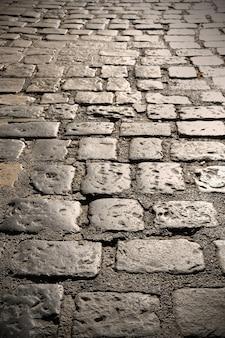 Gros plan de l'ancienne route pavée