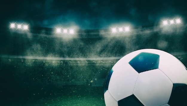 Gros plan d'un ballon de football au stade lors d'un match de nuit