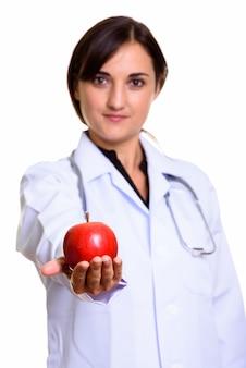 Gros plan, de, beau, docteur, donner pomme rouge