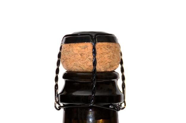 Gros plan de la bouteille de champagne et du liège