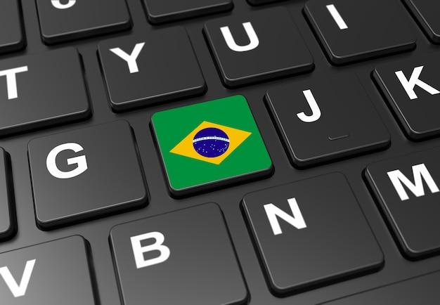 Gros plan d'un bouton avec le drapeau du brésil sur un clavier noir