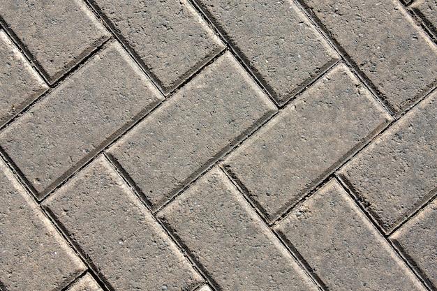 Gros plan d'une chaussée à motifs en uniforme de brique