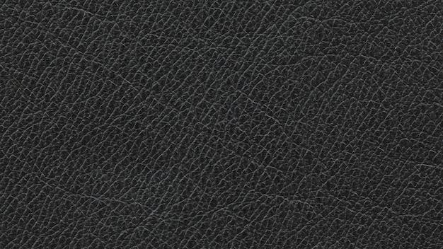 Gros plan, coup de macro de fond de texture de cuir noir naturel