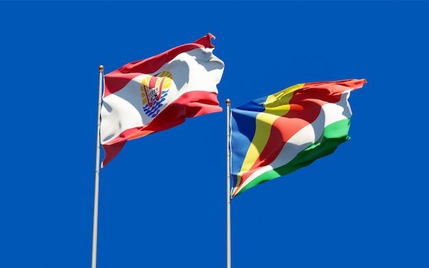 Gros plan sur les drapeaux de la polynésie française et des seychelles