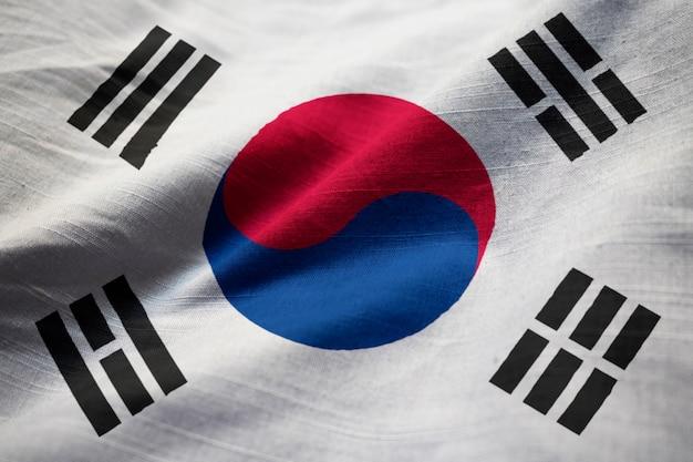 Gros plan du drapeau de la corée du sud ébouriffé, drapeau de la corée du sud soufflant dans le vent