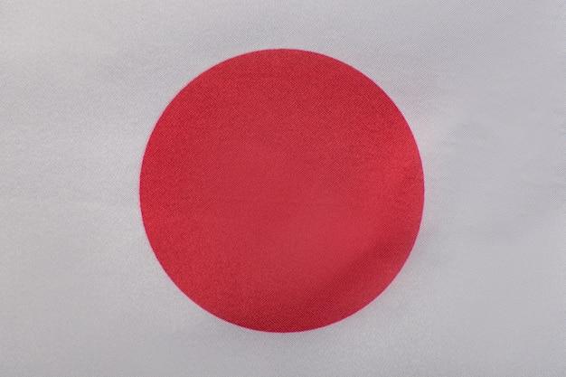 Gros plan du drapeau japonais. symboles nationaux du japon. la terre du soleil levant.