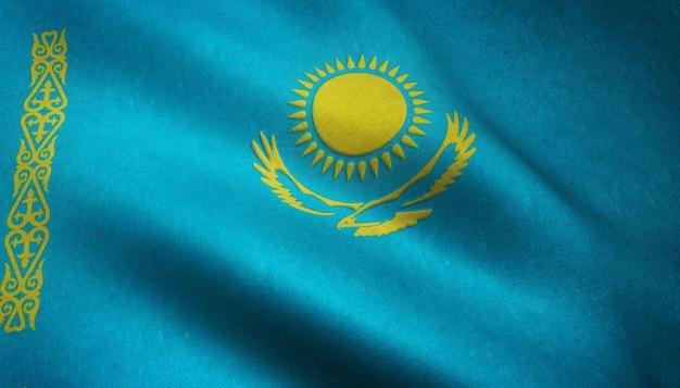 Gros plan du drapeau ondulant du kazakhstan avec des textures intéressantes