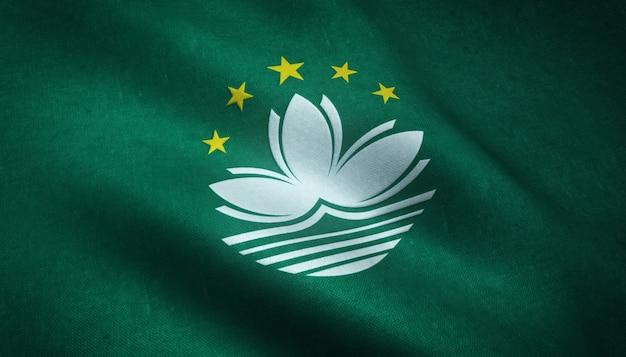Gros plan du drapeau ondulant de macao avec des textures intéressantes