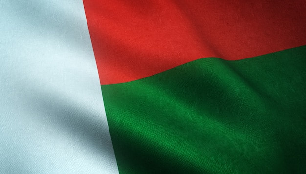 Gros plan du drapeau ondulant de madagascar avec des textures intéressantes